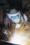 Welder wearing protective face mask welding at Work Royalty Free Stock Image