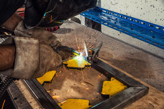 Welder weld a metal welding machine in a workshop Stock Photography