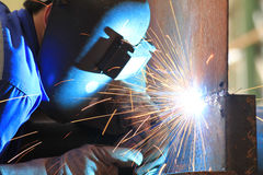 Welder is welding chekered plate with all safety Royalty Free Stock Image