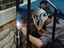 Welder Welding Clamped Metal. Welder welding steel for post repair Stock Photos