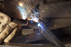 Welder welding on decorative handrail Stock Photos