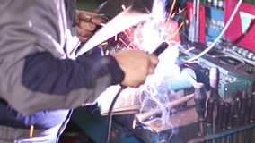 Welder with Welding Electrode on the Workbench Vice stock video footage