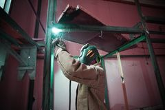 Welder welding in a factory Stock Images