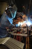 Welder Welding In An Industrial Factory Royalty Free Stock Images