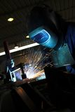 Welder welding a metal part Stock Photo