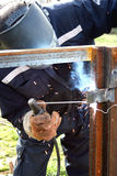Welder welding a metal part Royalty Free Stock Images