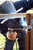 Welder welding a metal part Royalty Free Stock Images