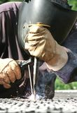 Welder welding a metal part Stock Photography