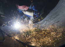 Welder welding metal and sparks. Welder with protective mask welding metal and sparks Royalty Free Stock Photos