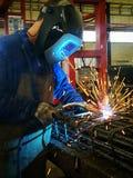 Welder welding rebar construction. Welder welding rebar for construction, metal, iron, rebar steel, industrial, industry, worker Royalty Free Stock Images