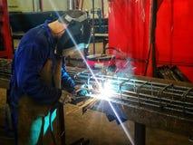 Welder welding rebar construction. Welder welding rebar for construction, metal, iron, rebar steel, industrial, industry, worker Stock Image