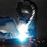 Welder with welding sparks. Welder with welding works sparks Royalty Free Stock Images