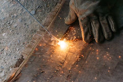 Welder Welding Sparks  steel in factory. Bodypart Royalty Free Stock Photography