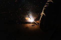 Welder Welding Sparks  steel in factory. Fast speed Stock Photos