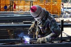 Welder welding  steel. On construction site Royalty Free Stock Images