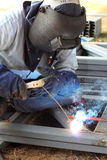 Welder welding steel Stock Image