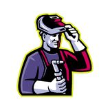 Welder Welding Torch Mascot. Mascot icon illustration of head of a welder lifting visor and holding welding torch viewed from side on isolated background in Royalty Free Stock Photo