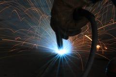 Welder is welding work piece with gloves safety Stock Image