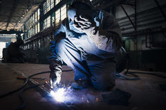 Welder welding in a workshop horizontal. Stock Photo