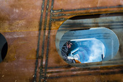 Welder welding in a workshop horizontal. Welder welding in a workshop Stock Photography