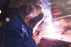 Welder welding in workshop Royalty Free Stock Photo