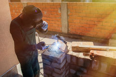 Welder welds on the building site Royalty Free Stock Image