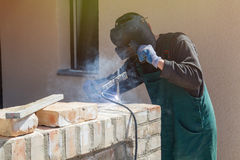 Welder welds on the building site Stock Images