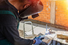 Welder welds on the building site Stock Photography