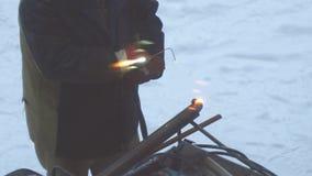 Welder welds metal parts with gas welding. Welder welds metal parts using gas welding outdoors in winter stock video