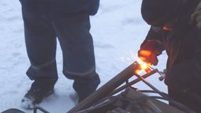 Welder welds metal parts with gas welding. Welder welds metal parts using gas welding outdoors in winter stock video footage