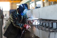 Welder welds metal parts stock photography