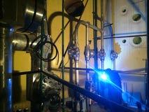 The welder welds a pipeline of stainless steel, argon-arc weldin. Welder at work with argon-arc welding Stock Photos