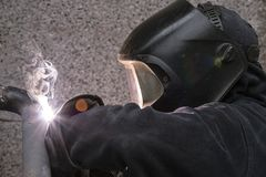 Welder welds pipes for gas installation stock image