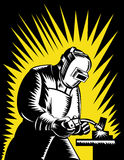 Welder at work. Vector illustration of a Welder at work retro woodcut style Stock Photography