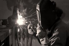 Welder by the work. Fire and mask Royalty Free Stock Photo