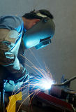 Welder at work. Welder working on metal tubes Royalty Free Stock Image