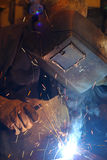 Welder at work. Man welding a metal structures Royalty Free Stock Photo