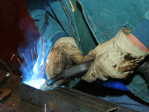 Welder at work. Wearing gloves Royalty Free Stock Photo