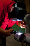 Welder at work. At a pipeline Royalty Free Stock Image