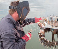 Welder at work. In the water excavator Royalty Free Stock Photo