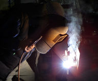Welder at work. Welding crack in cast iron stock photos