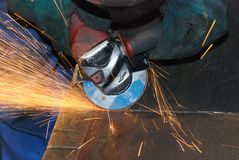 Welder at work. A metal welder busy at work Royalty Free Stock Photo