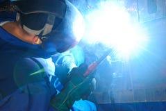 Welder at work. A metal welder busy at work Stock Photos