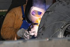 Welder at work. A metal welder busy at work Royalty Free Stock Image