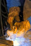 Welder at work. A metal welder busy at work Stock Photography
