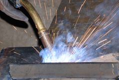 Welder at work. A metal welder busy at work Stock Images