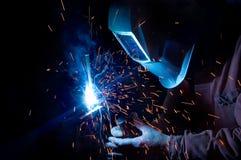 Welder at work. Welder is welding metal tools Stock Image