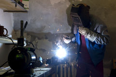 Welder by the work. In the workroom Stock Image