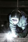 Welder at work. Man is weldind a big place of steel Stock Photos
