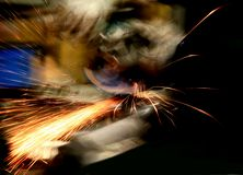 Welder at work - blurred. Blurred picture of a welder at work stock photography